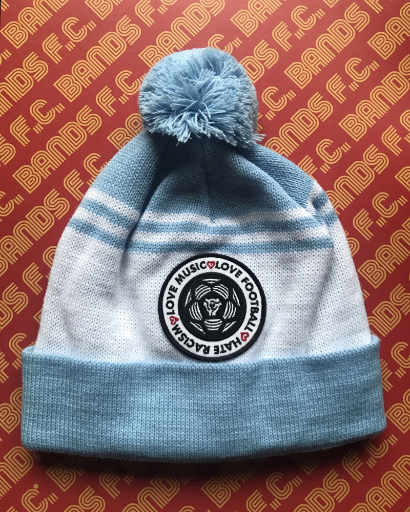 Love Music Love Football Hate Racism bobble hat in light blue on red background